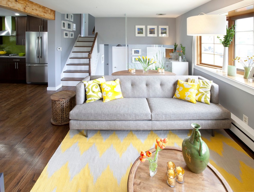 Transitional brown floor living room photo in New York with gray walls