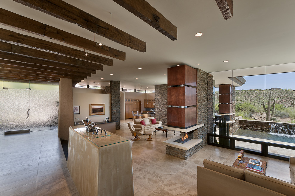 Inspiration for a southwestern open concept living room remodel in Phoenix with white walls and a two-sided fireplace