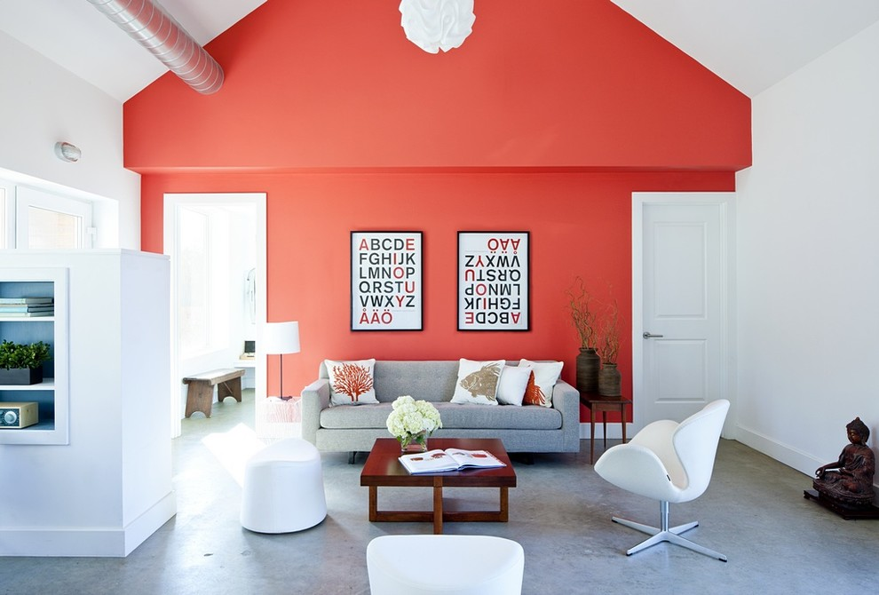 Example of a country concrete floor living room design in Providence