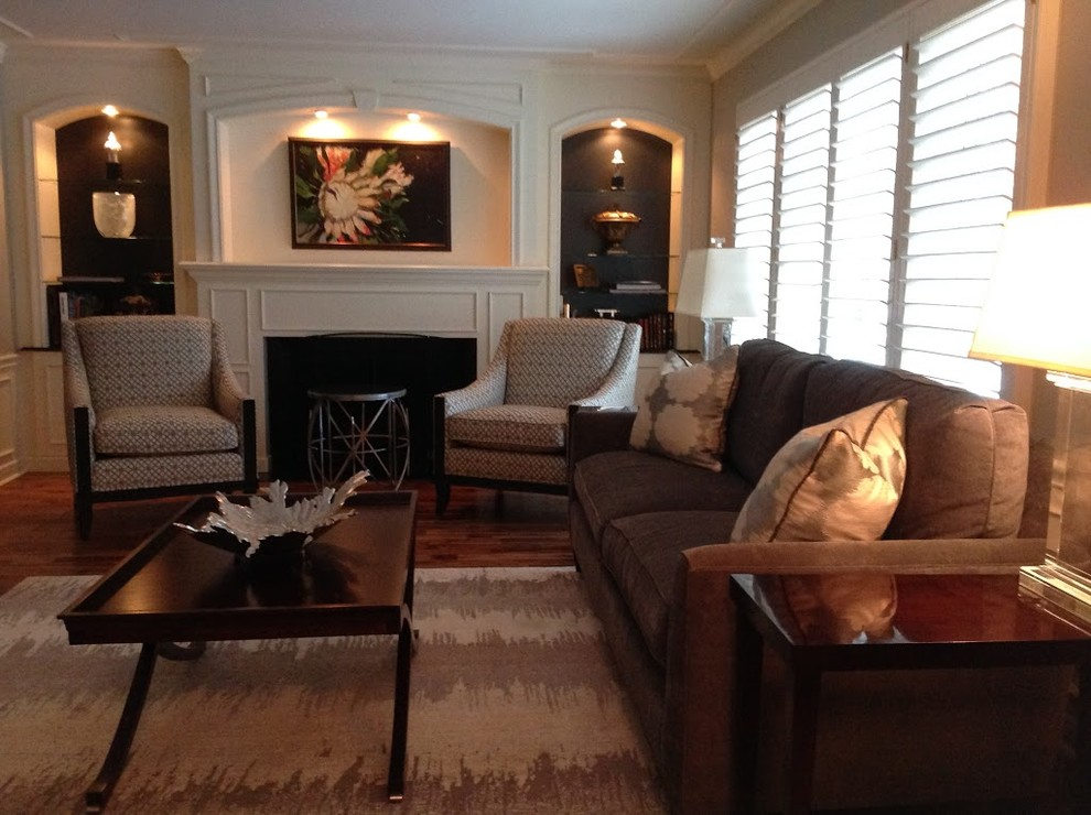 Mid-sized transitional formal and enclosed medium tone wood floor living room photo in Chicago with gray walls, no tv, a standard fireplace and a wood fireplace surround