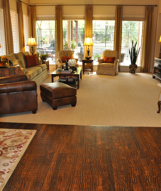 Patterned carpet and hand scraped wood floor traditional Carpet or wooden floor in living room