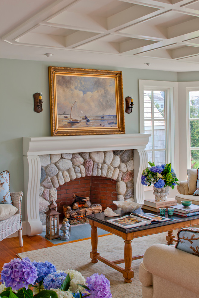 Inspiration for a mid-sized coastal formal and enclosed medium tone wood floor and brown floor living room remodel in Boston with green walls, a standard fireplace, a stone fireplace and no tv