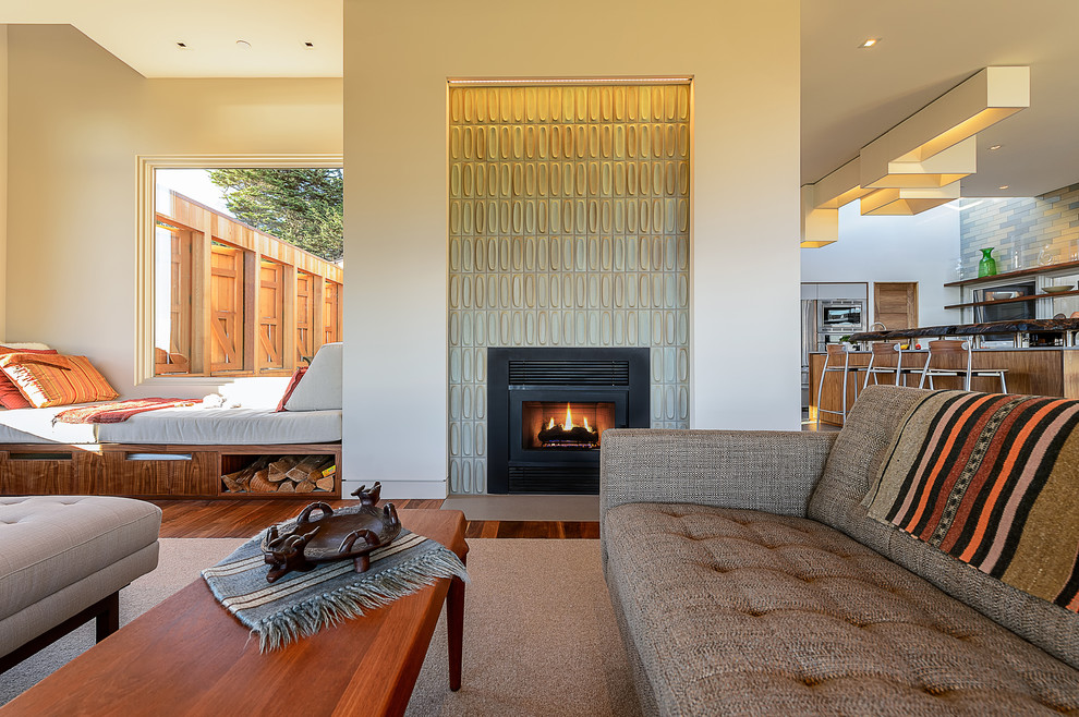 Inspiration for a contemporary formal and open concept medium tone wood floor living room remodel in San Francisco with white walls, a standard fireplace, a tile fireplace and no tv