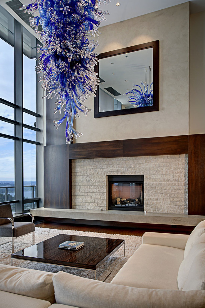 Inspiration for a contemporary living room remodel in Seattle with a stone fireplace