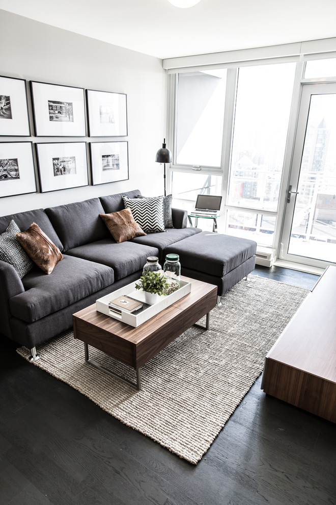 Inspiration for a mid-sized contemporary formal dark wood floor and brown floor living room remodel in Vancouver with a wall-mounted tv and gray walls