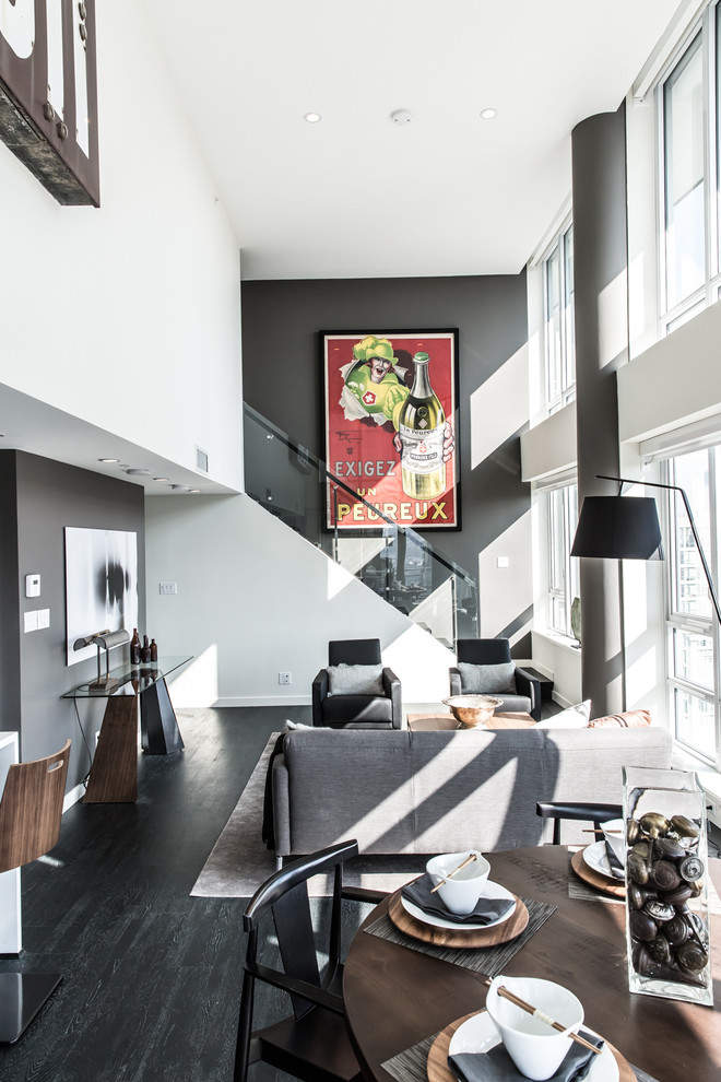 Living room - mid-sized 1960s formal and loft-style dark wood floor and black floor living room idea in Vancouver with gray walls