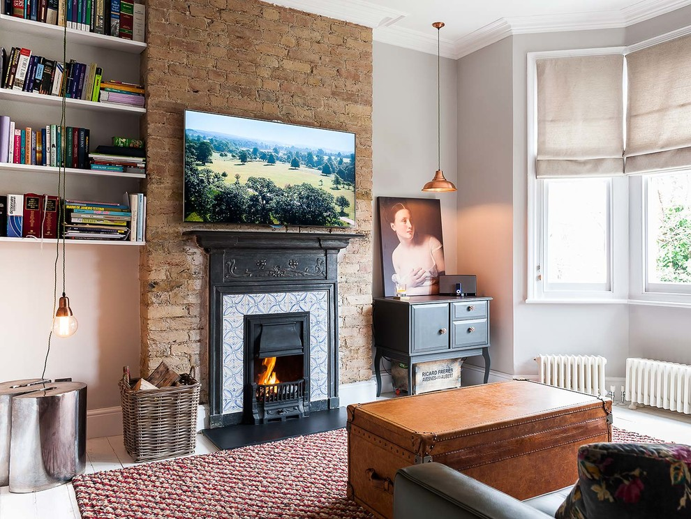 Inspiration for a large transitional formal and enclosed painted wood floor living room remodel in London with gray walls, a standard fireplace, a tile fireplace and a wall-mounted tv