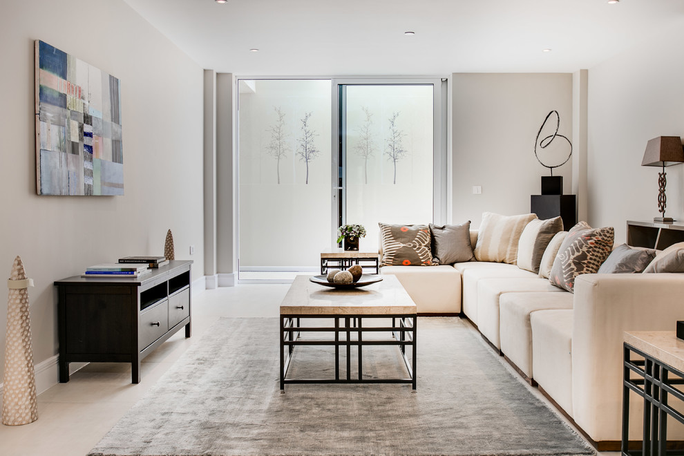 Example of a transitional living room design in London with beige walls