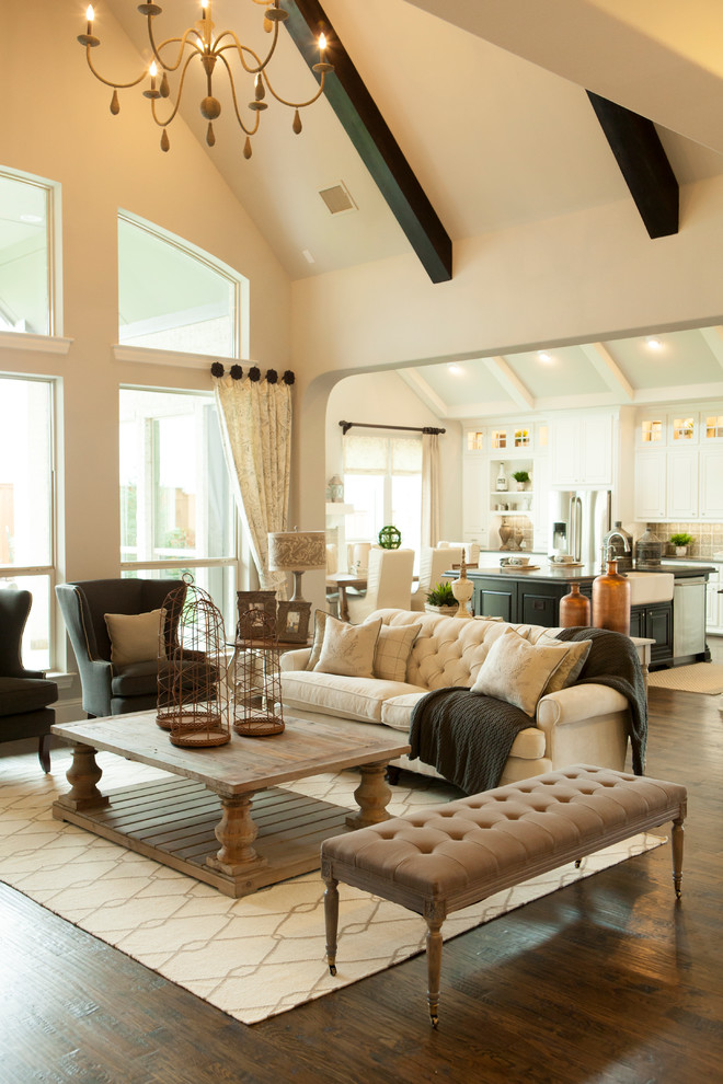 Example of a classic formal and open concept dark wood floor living room design in Dallas with beige walls