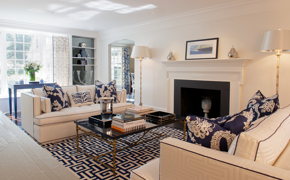 Example of a large beach style enclosed and formal living room design in New York with white walls, a standard fireplace, a plaster fireplace and no tv