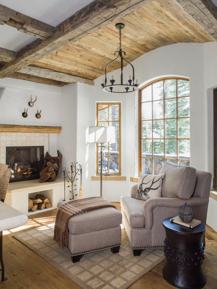 Mountain style medium tone wood floor living room photo in San Francisco with white walls, a standard fireplace and a tile fireplace