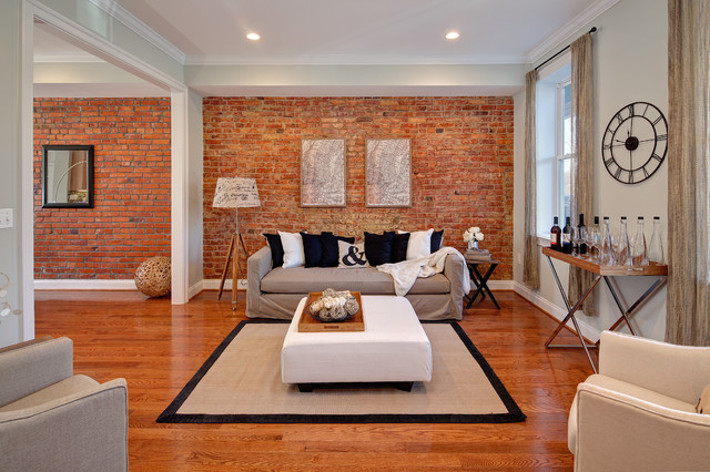 Example Of An Eclectic Medium Tone Wood Floor And Orange Living Room Design In DC