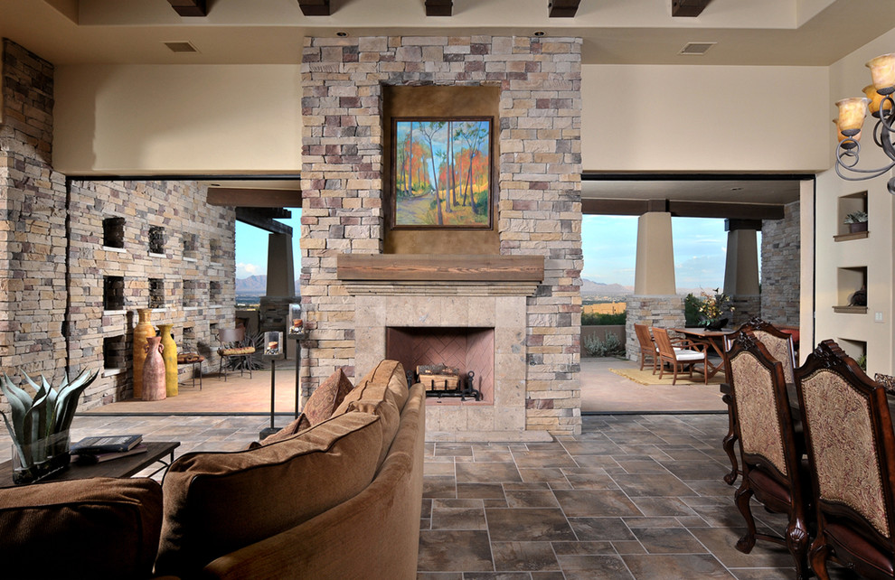 Example of a tuscan living room design in Austin with a stone fireplace
