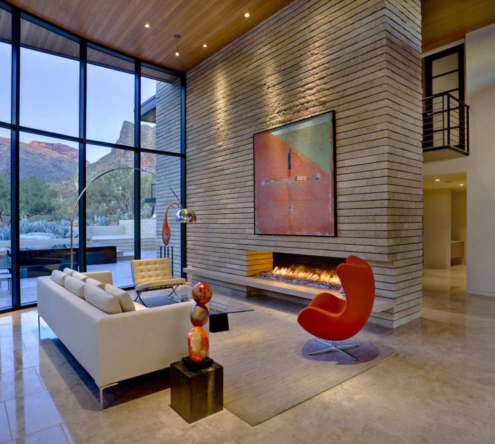 Inspiration for a large contemporary open concept living room remodel in Phoenix with a ribbon fireplace