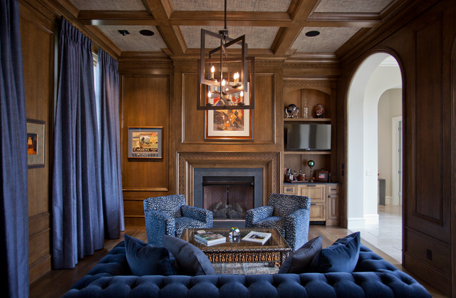 Inspiration for a mid-sized mediterranean open concept dark wood floor and brown floor living room library remodel in Other with brown walls, a standard fireplace, a wood fireplace surround and a wall-mounted tv
