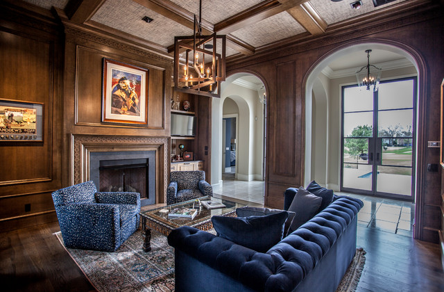 Living room - mid-sized mediterranean enclosed and formal dark wood floor and brown floor living room idea in Other with brown walls, a standard fireplace, a wall-mounted tv and a concrete fireplace