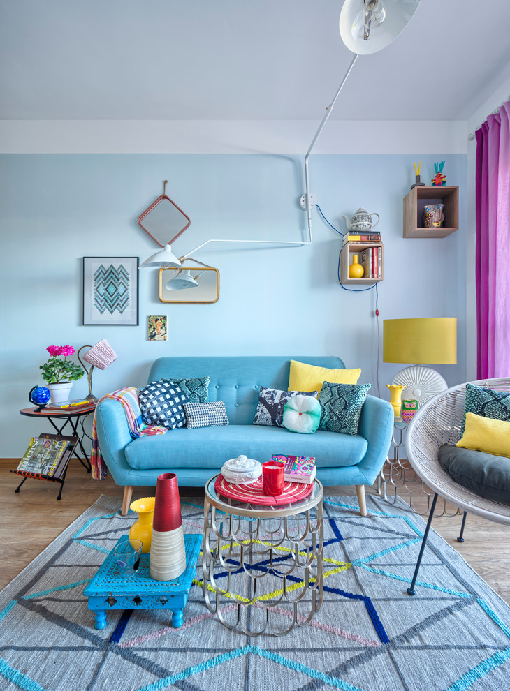 Inspiration for a mid-sized eclectic formal and enclosed light wood floor living room remodel in Malaga with blue walls, no fireplace and no tv
