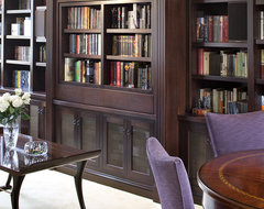 Pivoting TV turning into bookcase traditional-living-room