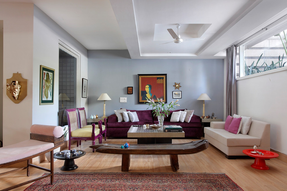 Living room - mid-sized contemporary formal and enclosed light wood floor and beige floor living room idea in Delhi with white walls