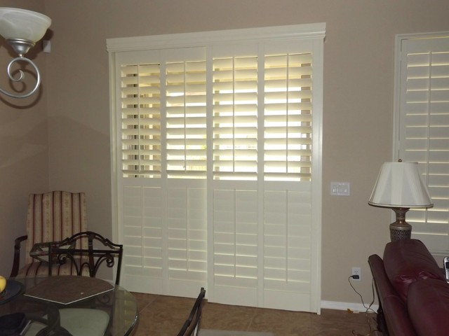 plantation shutters sliding glass doors traditional living room window blinds bypass over