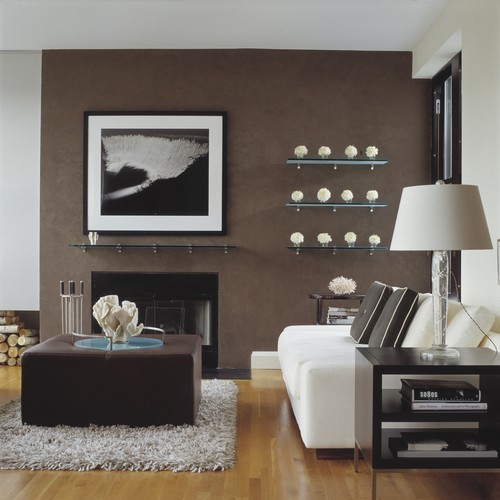 a modern space with a white sofa and lamp and brown walls and coffeetable