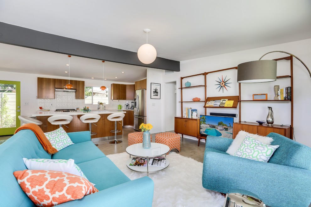 Inspiration for a mid-century modern open concept concrete floor and gray floor living room remodel in Other with white walls and a tv stand