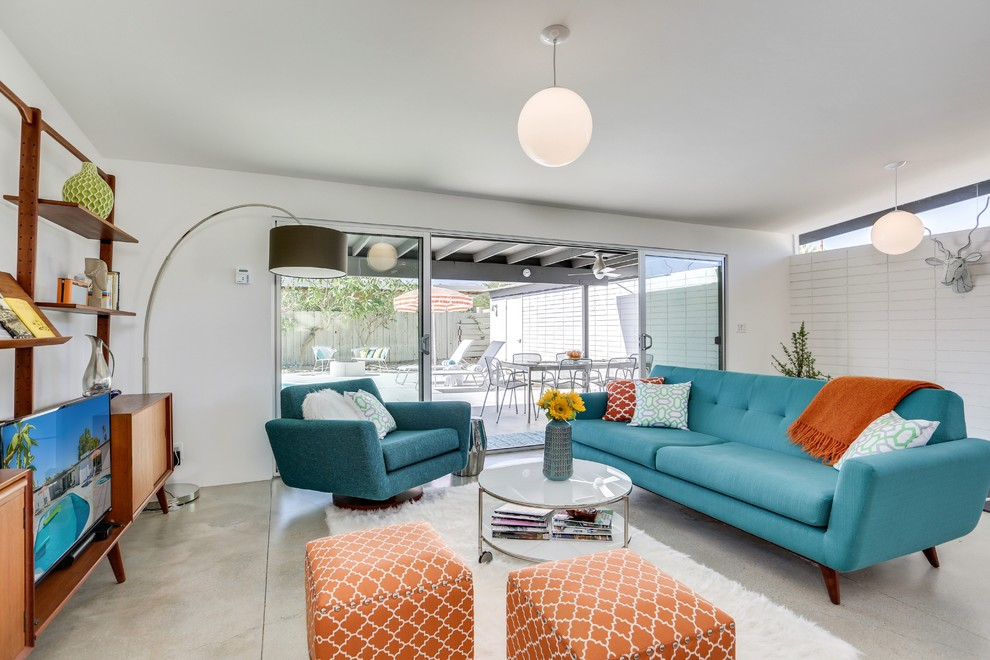 Mid-sized 1960s ceramic tile living room photo in Los Angeles with white walls and no fireplace