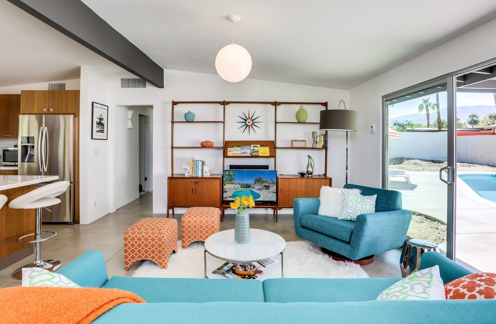 Living room - mid-sized 1950s ceramic tile living room idea in Los Angeles with white walls and no fireplace