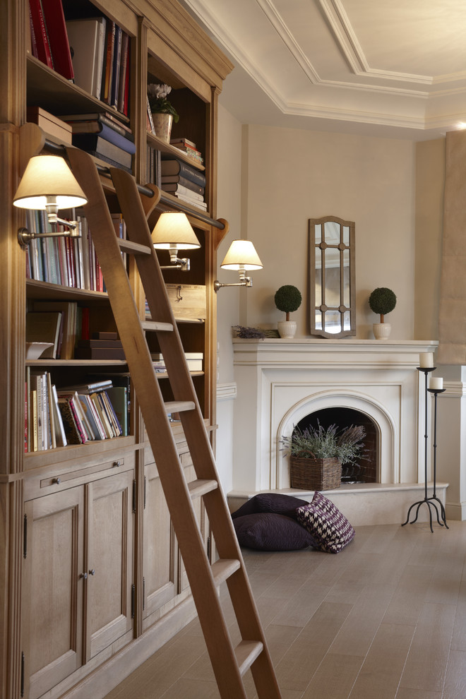 Example of a trendy living room design with a corner fireplace and a plaster fireplace