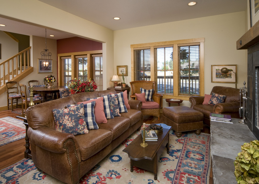 Example of a classic living room design in Seattle with beige walls