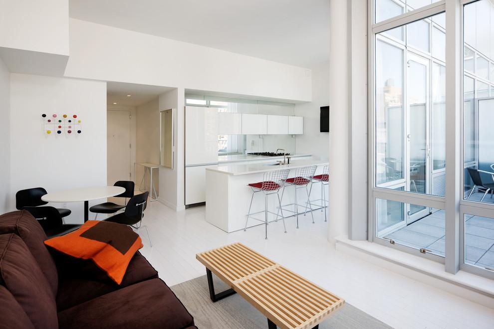 Minimalist open concept living room photo in New York