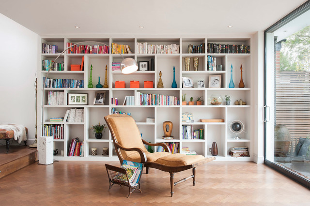 Example Of A Trendy Open Concept Light Wood Floor Living Room Library Design In London