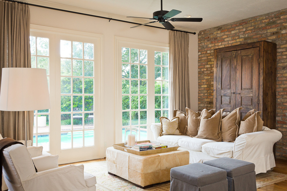 Inspiration for a timeless living room remodel in Houston with white walls