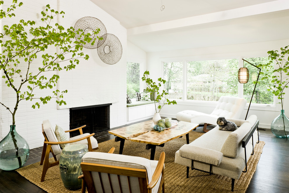 Example of a 1950s living room design in Portland with white walls