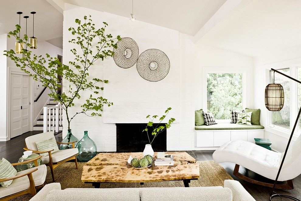 Example of a transitional living room design in Portland with white walls and a standard fireplace