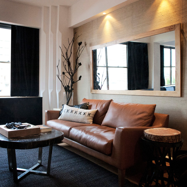 Example of a trendy living room design in Sydney with beige walls. Black Leather Sofa Ideas   Houzz