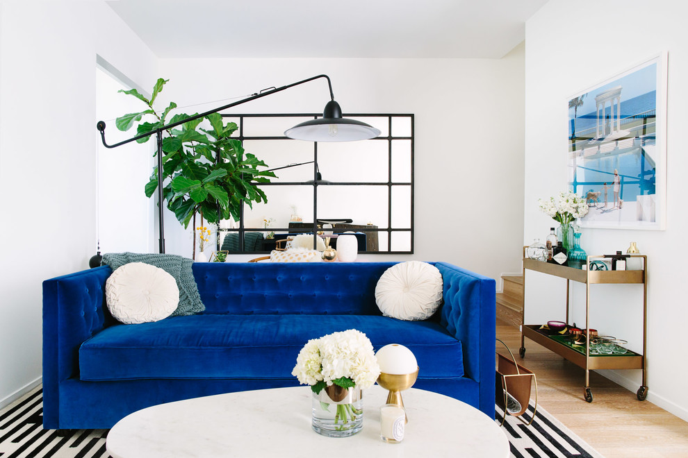 Example of a trendy light wood floor living room design in Los Angeles with white walls