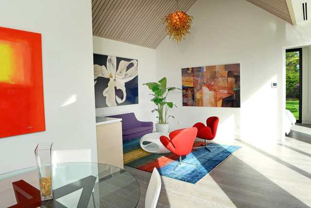 Inspiration for a contemporary open concept light wood floor living room remodel in Miami with white walls