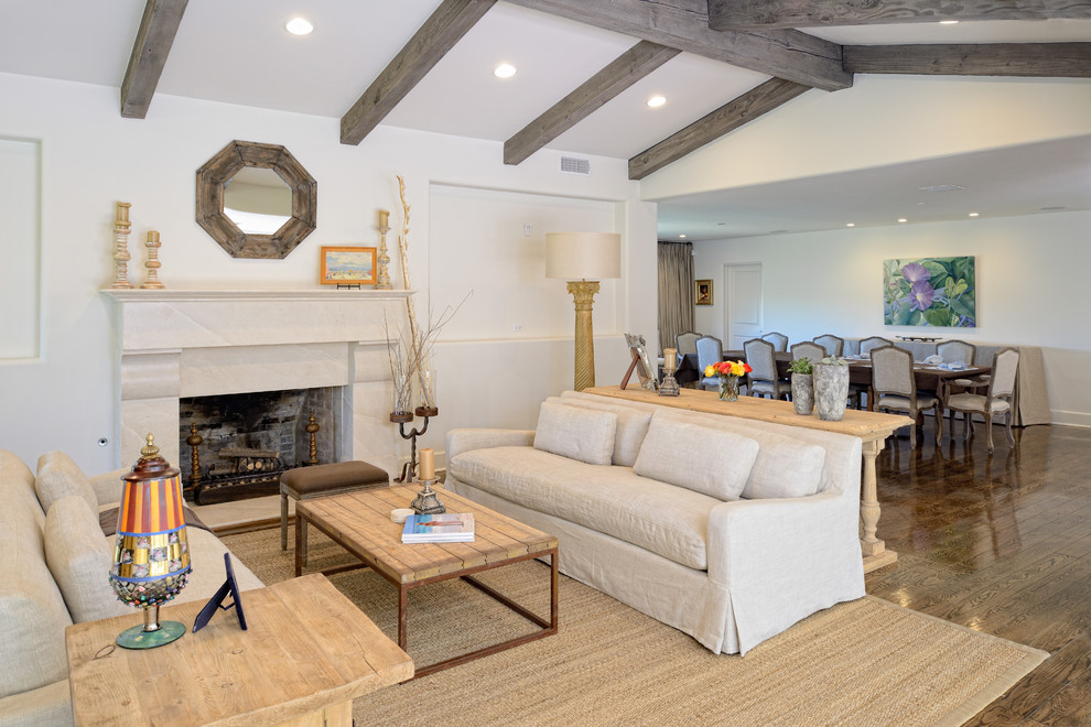 Inspiration for a timeless living room remodel in Austin with white walls and a standard fireplace