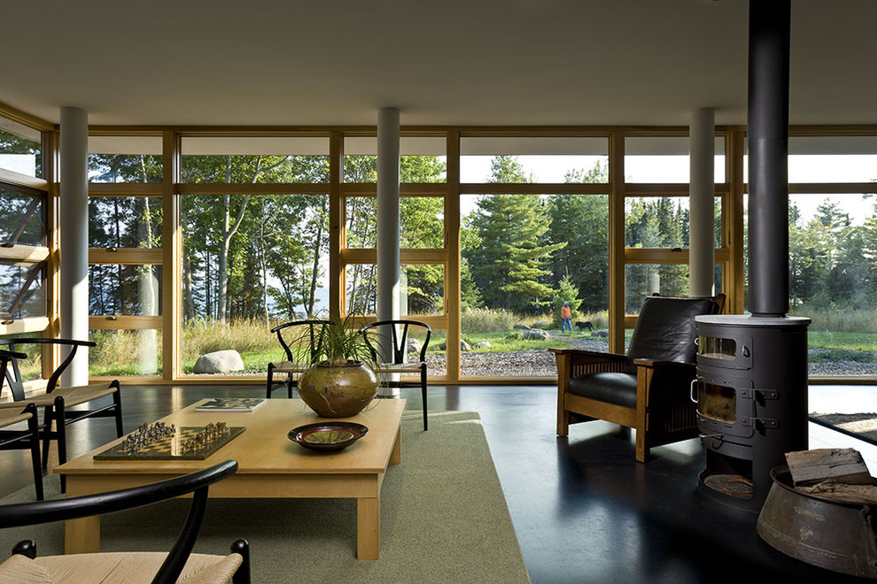 Example of a minimalist open concept living room design in Minneapolis with a wood stove