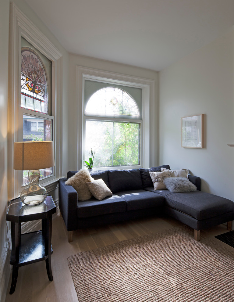 Inspiration for a mid-sized modern living room remodel in Toronto with white walls