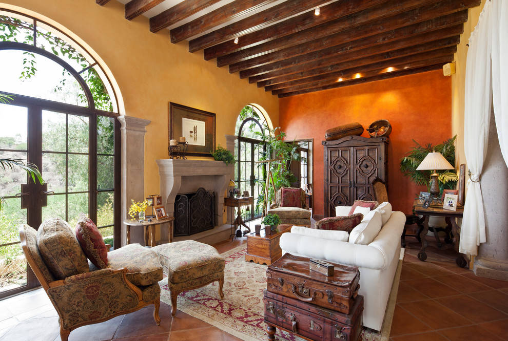 Living room - mediterranean terra-cotta tile living room idea in Seattle with a standard fireplace