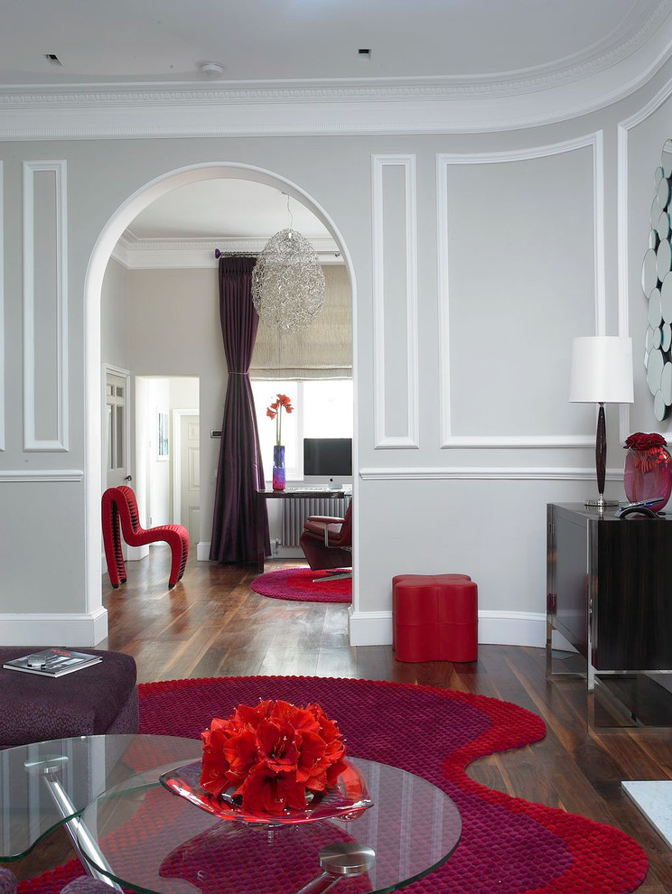 Example of a trendy enclosed living room design in London with gray walls and no tv