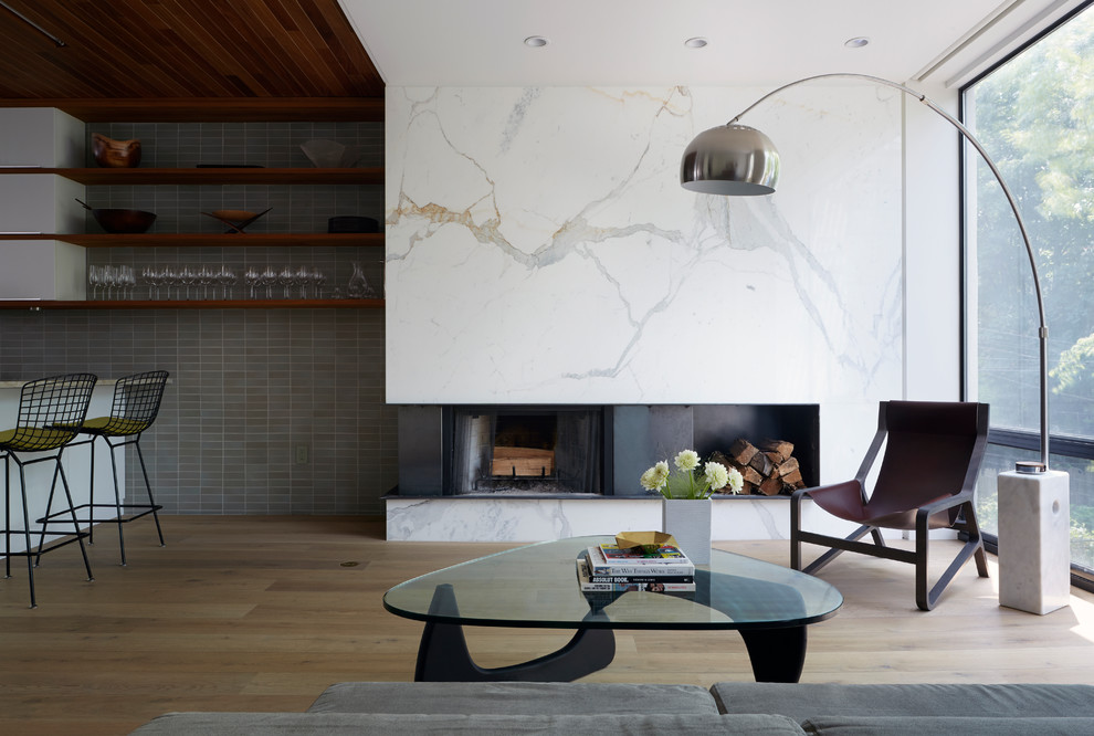 Example of a trendy formal and open concept light wood floor living room design in New York with a ribbon fireplace