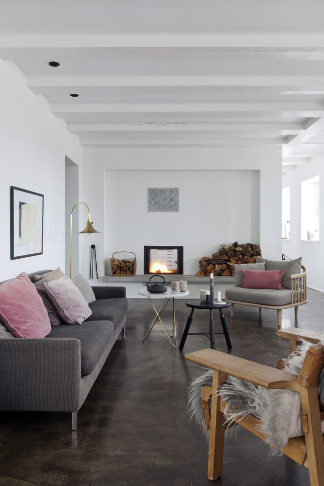 Living room - large scandinavian formal and open concept concrete floor and brown floor living room idea in Barcelona with white walls, a standard fireplace and no tv