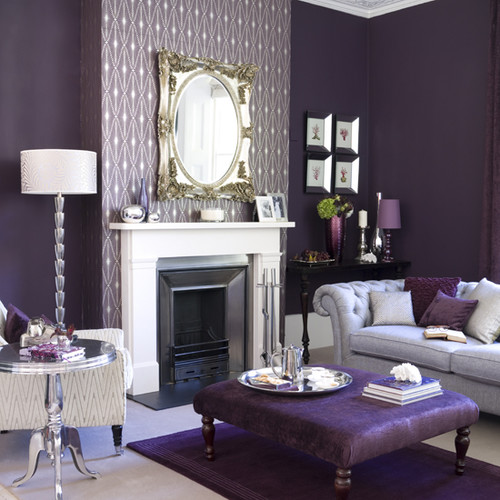 a beautiful living room that features the color purple and a selection of vintage pieces