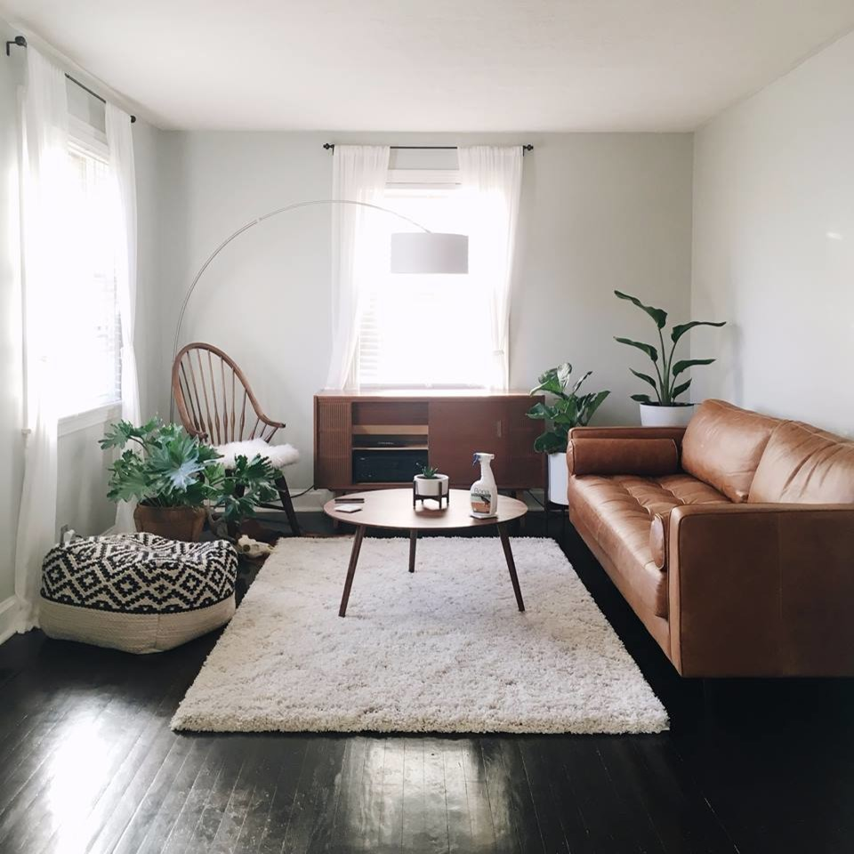 Inspiration for a mid-sized mid-century modern formal and open concept painted wood floor and black floor living room remodel in Philadelphia with white walls, no fireplace and no tv