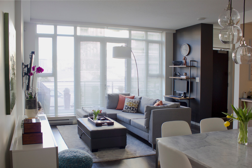 Small minimalist open concept dark wood floor living room photo in Vancouver with white walls and a wall-mounted tv
