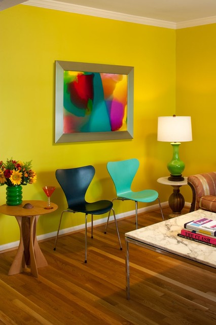 Example of an eclectic living room design in Atlanta with yellow walls
