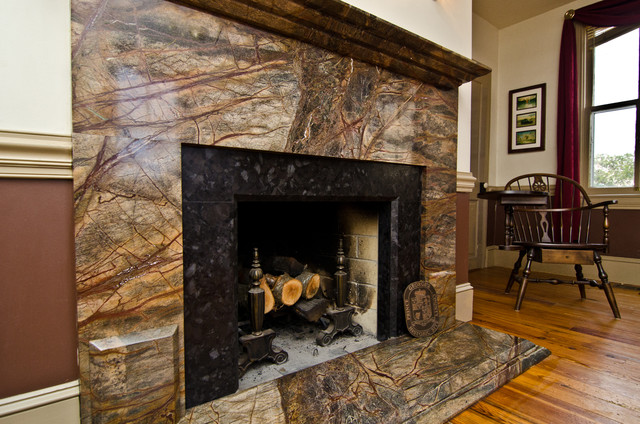This is Rainforest Green Granite with an inner border of Leathered Antique Brown Granite. This is one of four fireplaces in the home of Granite Grannies
